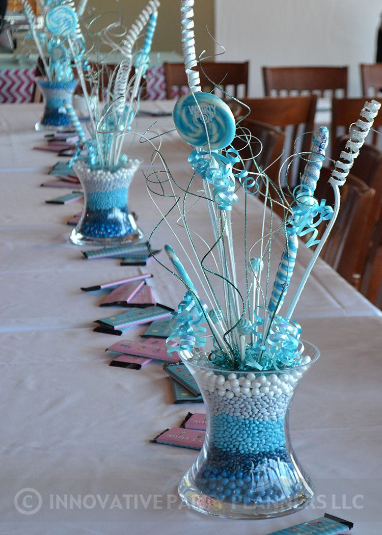 Adult centerpieces were ombre stacked candy in a gorgeous glass vase ...
