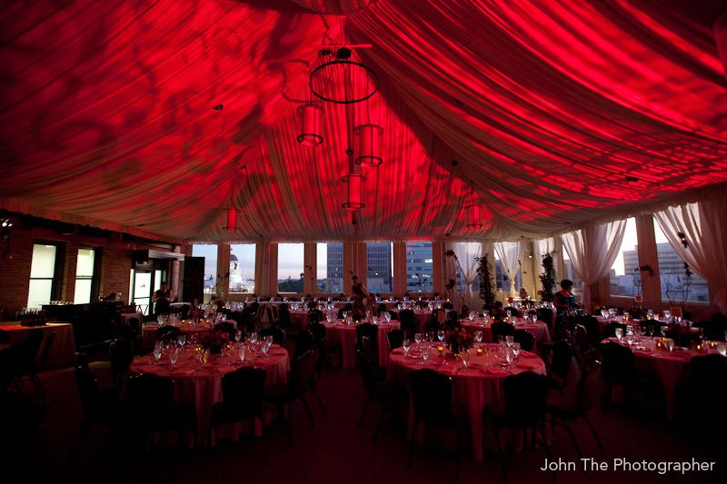 An overview of the reception area with red up lighting at the wedding venues junglespirit Gallery