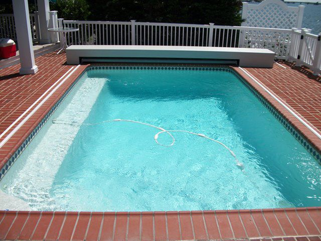 Great idea for existing pools automatic pool cover - Covering a swimming pool with decking ...
