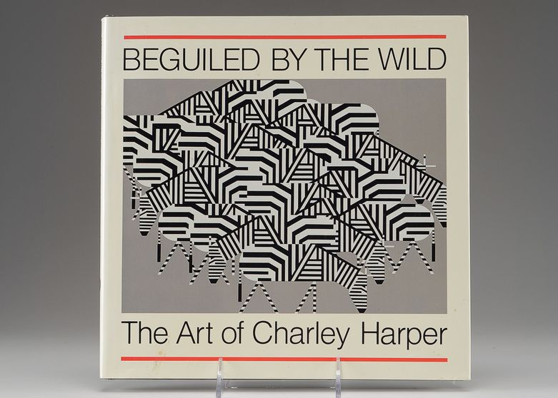 "A copy of ""Beguiled by the Wild: The Art of Charley Harper,"" (Flower Valley Press, 1994) signed by the artist"