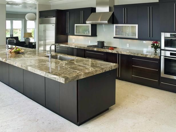 In This Large Kitchen The Equally Large Aircraft Carrier Of An Island As The Bu Kitchen Countertop Choices Contemporary Kitchen Contemporary Kitchen Design