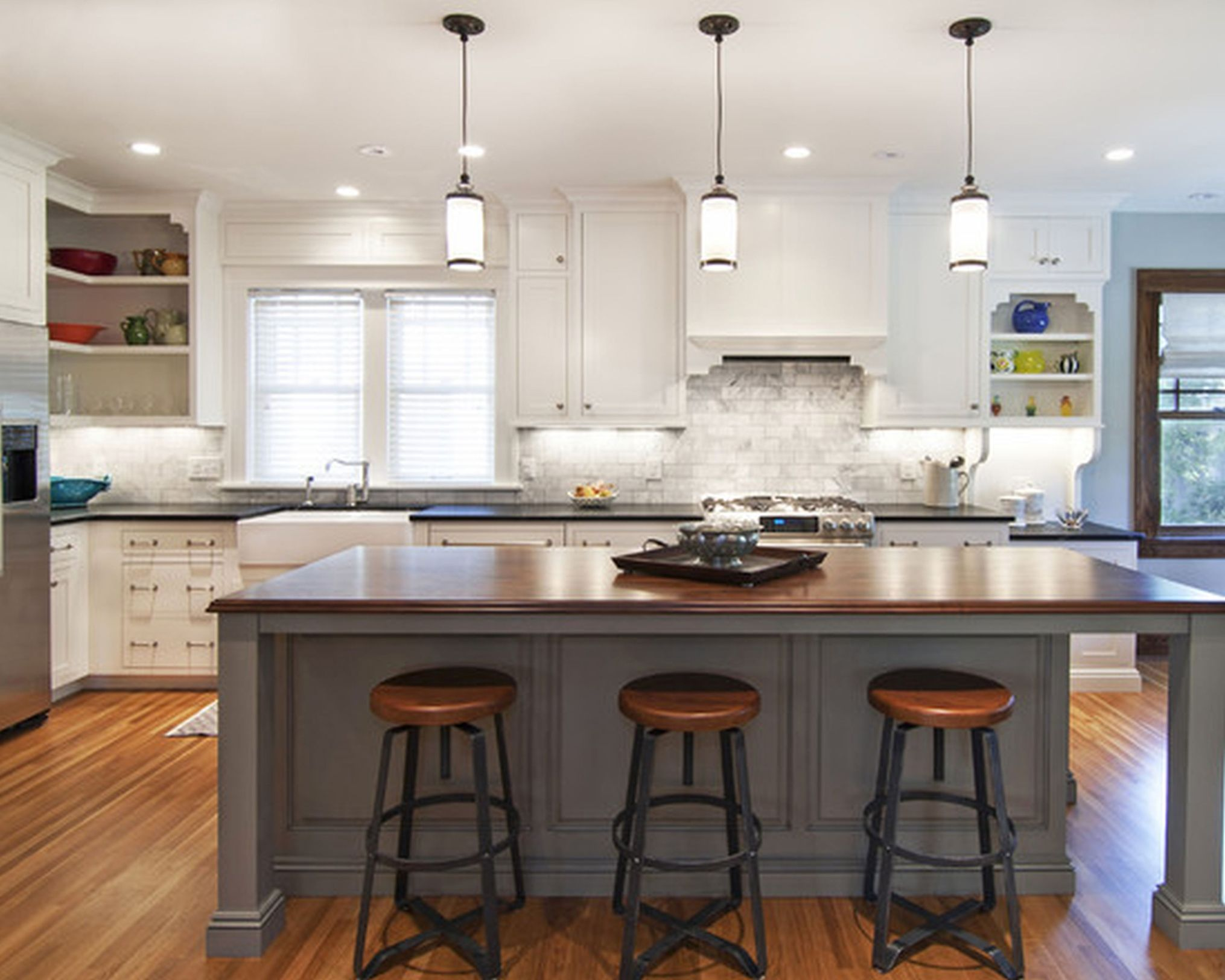 Grey And White Kitchen With Island white-kitchen-cabinets-bay-window-pendant-lights-over-kitchen