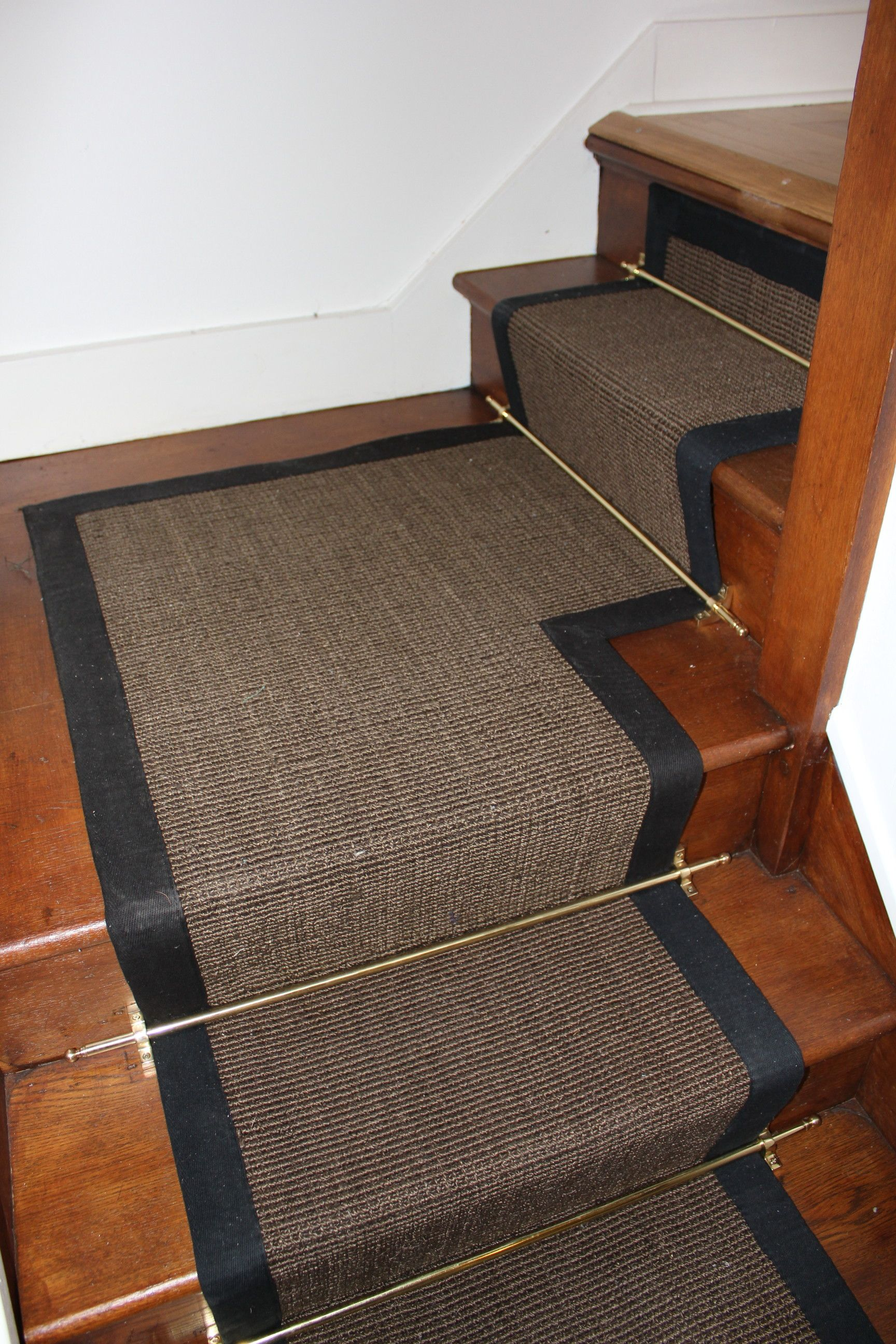 Black And Gray Fitted Carpet Runner On Cherry Finished Wooden Stair Using  Golf Polished Iron Holder With Rugs And Runners Also Carpet Runners On  Stairs .