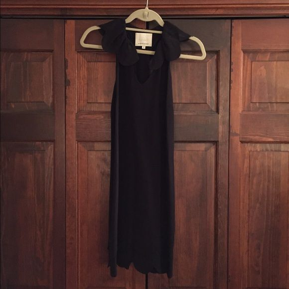 Madison Marcus Racerback Scalloped-Edge Dress Black silk dress from Madison Marcus in a size small. Racerback in the back and V neck in front. Very comfortable and easy to wear. Scalloped collar on the top and a double scalloped edge on the bottom Madison Marcus Dresses Midi