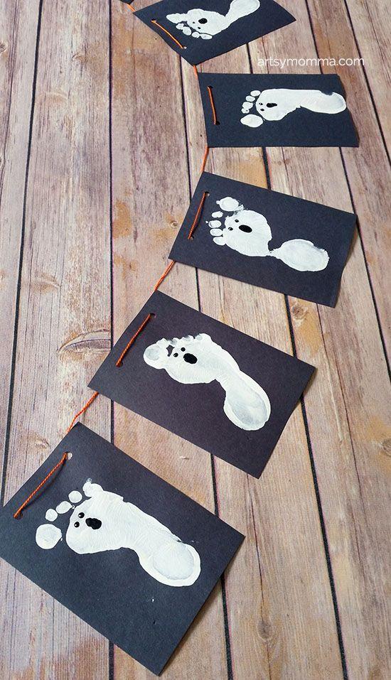 Kid-made Halloween Banner with Ghost Footprints #halloweencraftsfortoddlers