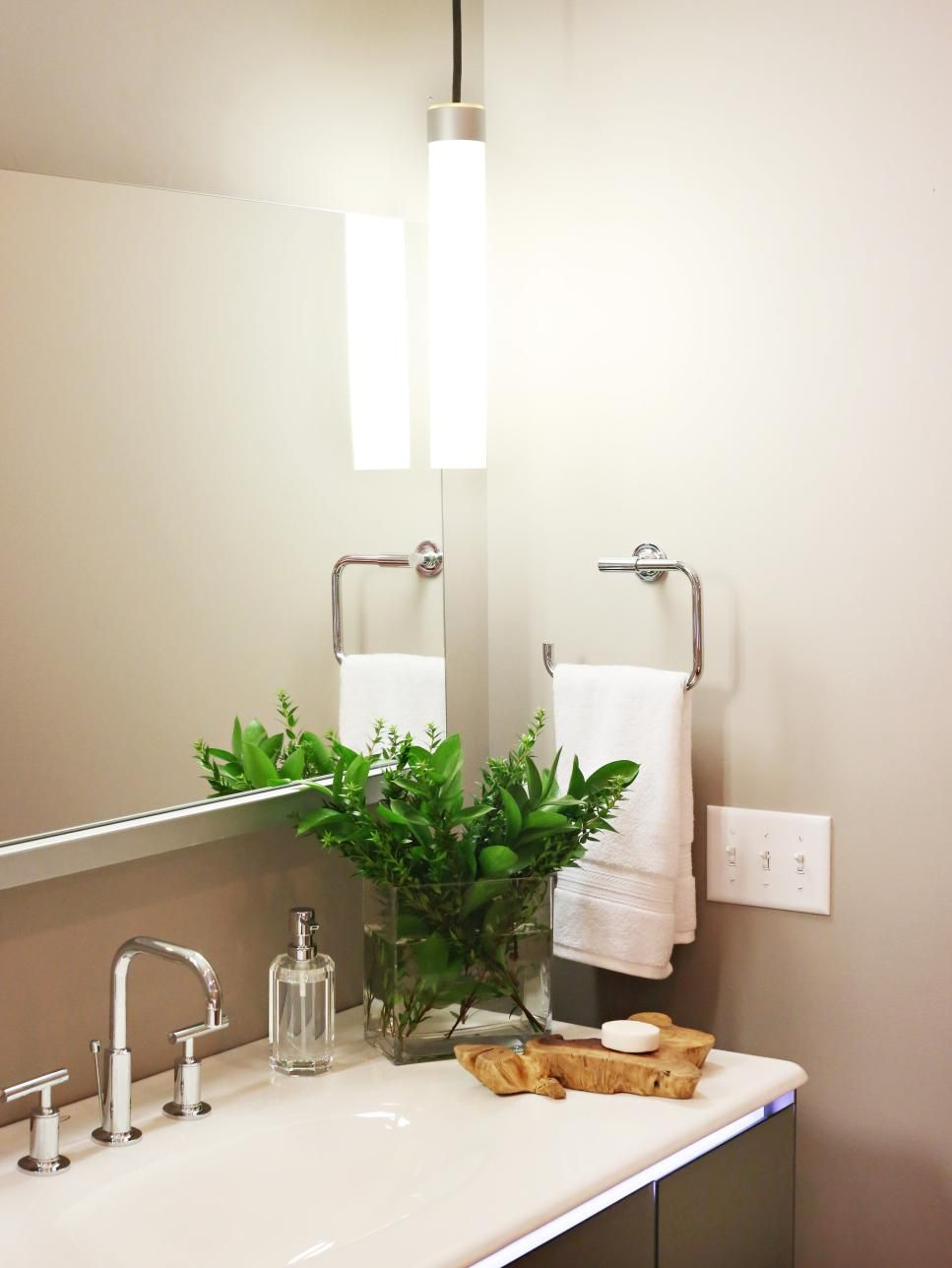 Pendant lights in front of large mirror modern hand towel bar