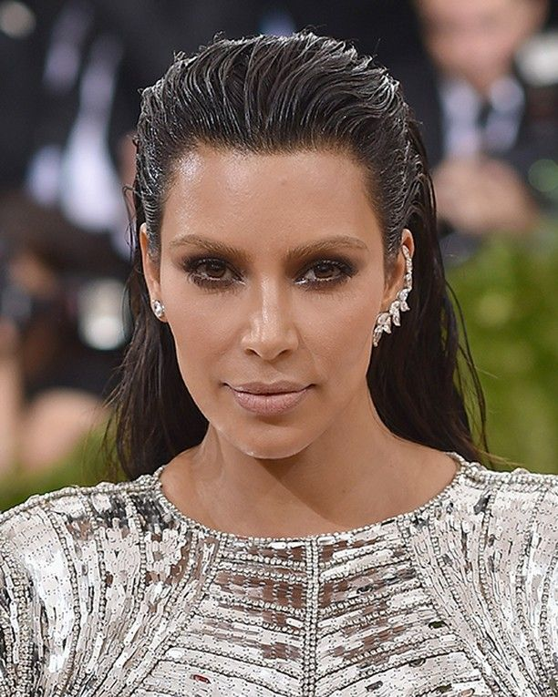 Kim Kardashian's Makeup Artist Used This Trick to Make Her Eyes Look Bigger at the Met Gala  Yes Kim Kardashian showed up at the Met Gala last night with bleached eyebrows (and yes Kanye West was wearing bright-blue contacts) but that's not the part of her beauty look we're dying to steal. No that award goes to the way her longtime makeup artist Mario Dedivanovic used five different tones of bronze from one of your favorite budget brands to perfect Kardashian's signature eye look…