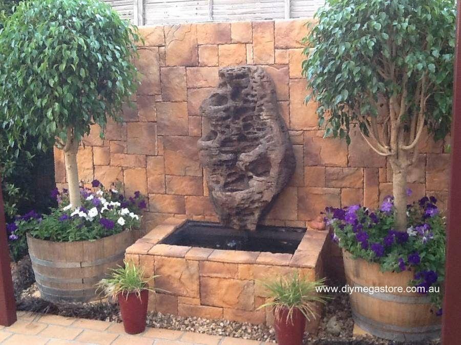 Arreglo de jard n con macetas plantas piedra y la - Fuentes de patio ...