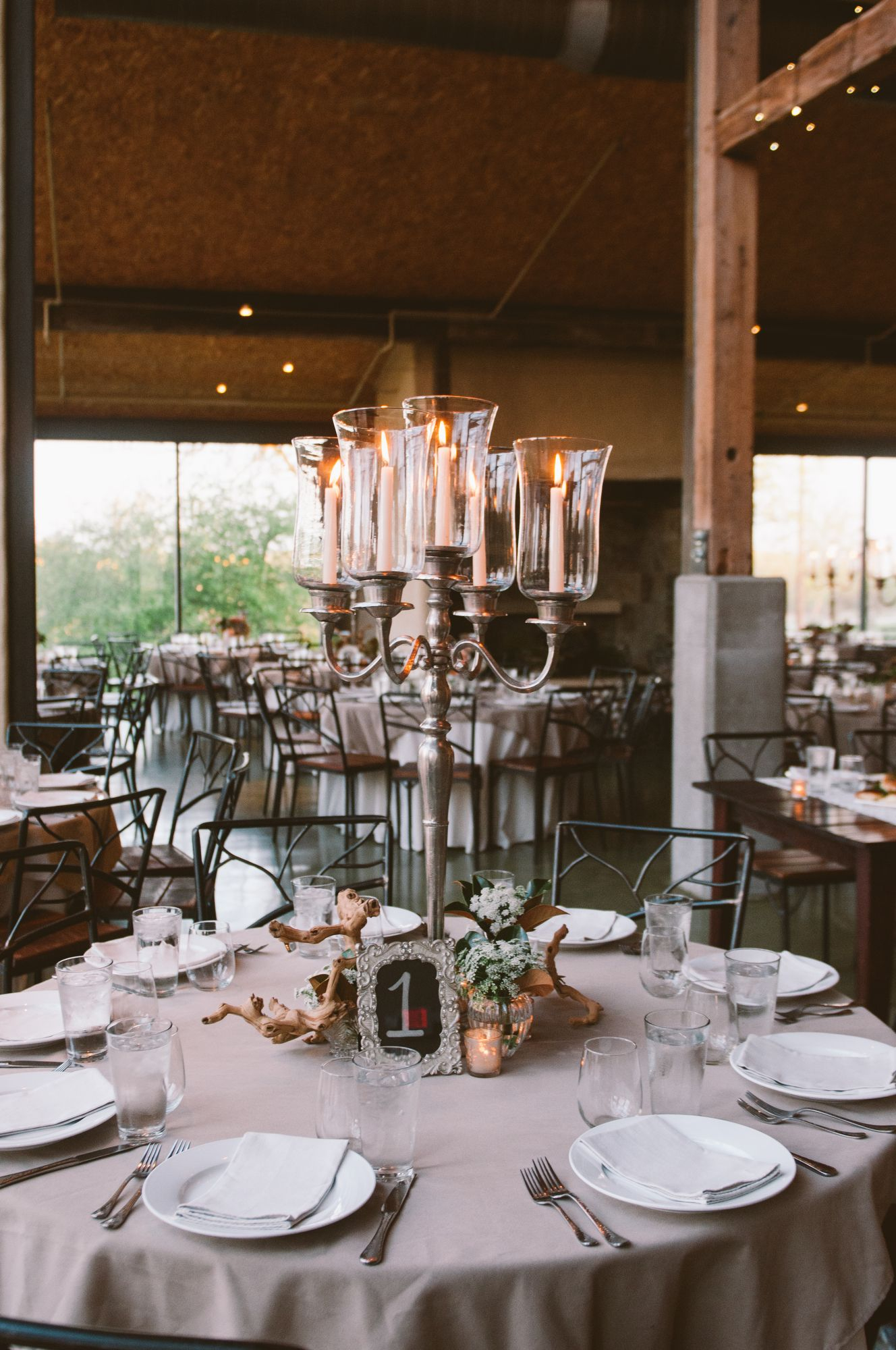 Option for the alternative tall centerpiece silver candelabras option for the alternative tall centerpiece silver candelabras with taper candles in glass hurricanes surrounded at the base by a trio of gold vases reviewsmspy