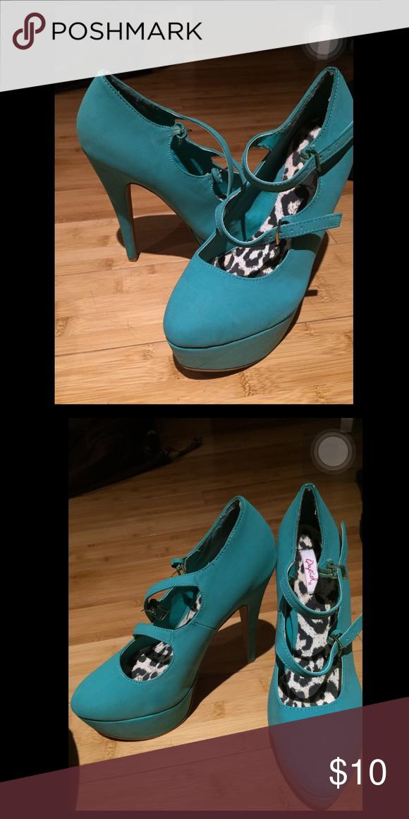 Heels Greenish colored heels. Kind of tall but super comfortable. Shoes Heels