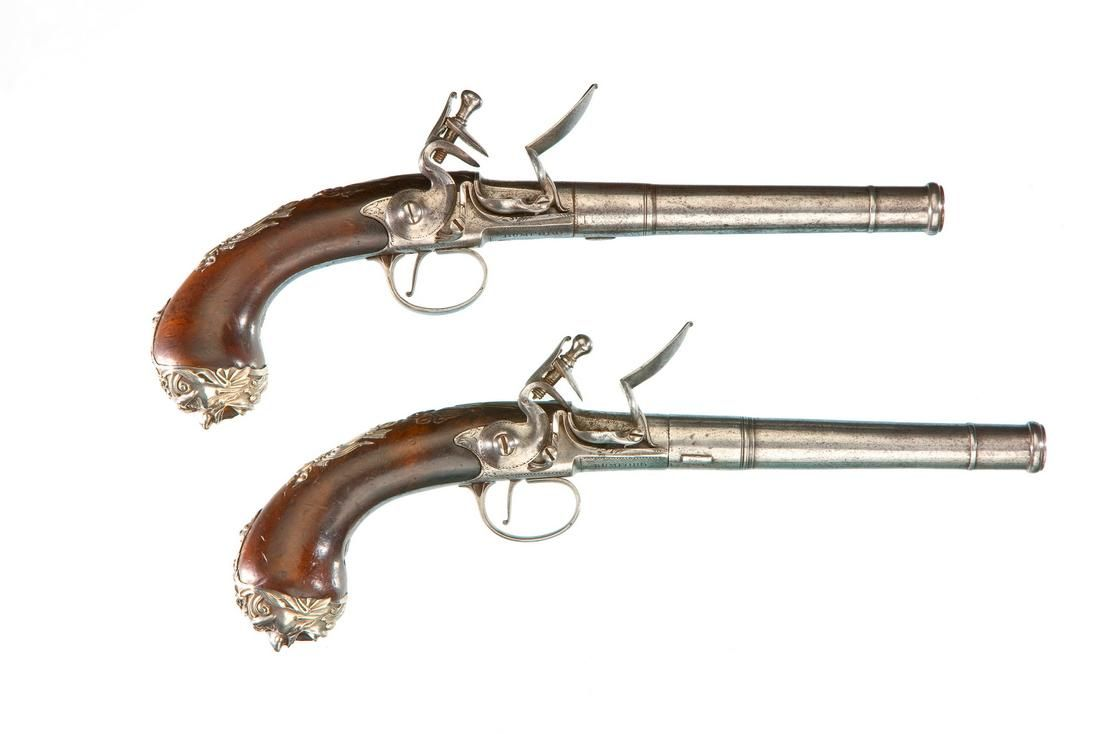 A Pair Of Silver Mounted Flintlock Turn Off Pistols By John Bumford London Circa 1765 Flintlock Pistol Black Powder Guns Antique Guns