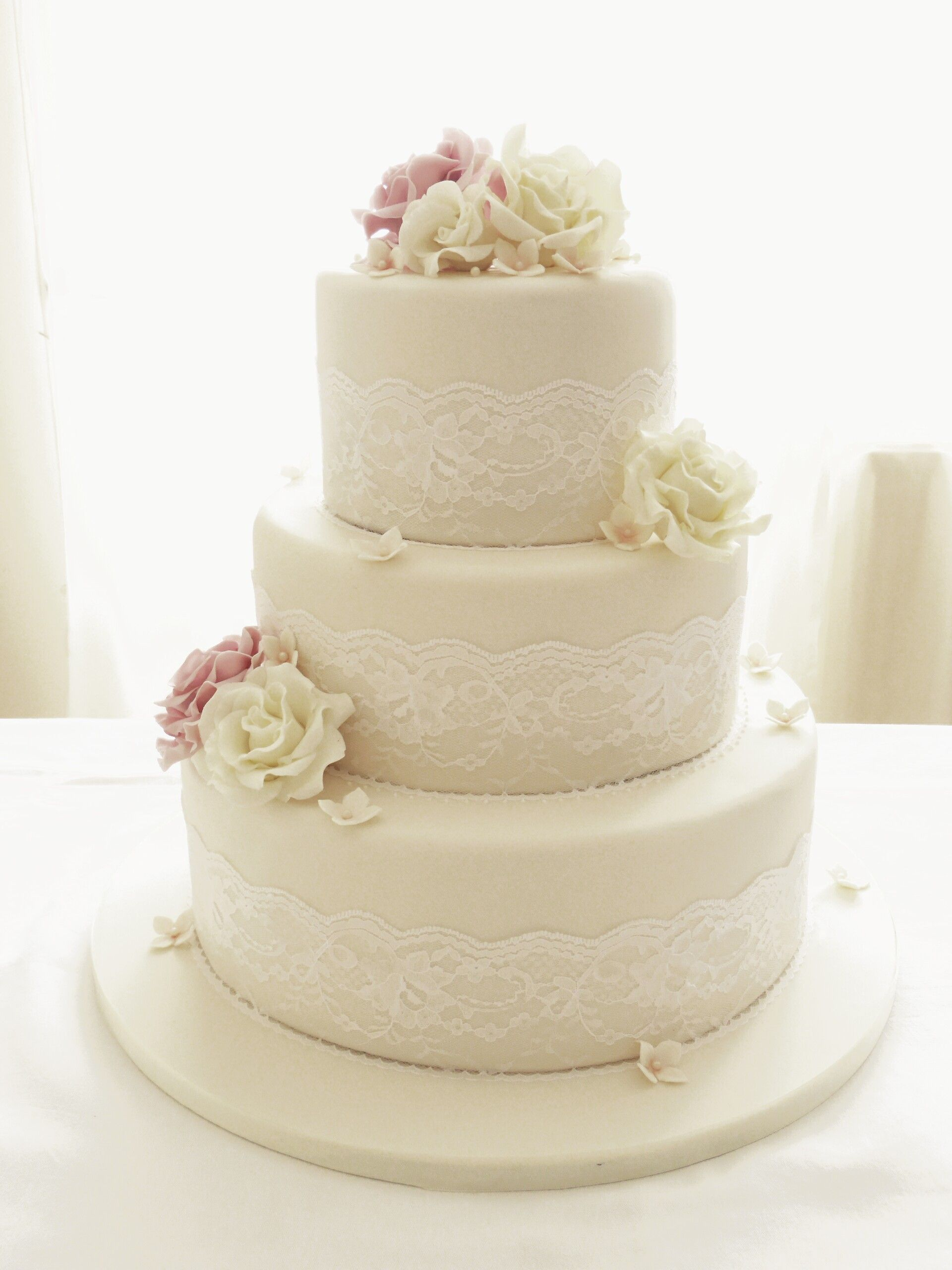 Round Wedding Cakes Ivory Roses And Lace Three Tier Cake