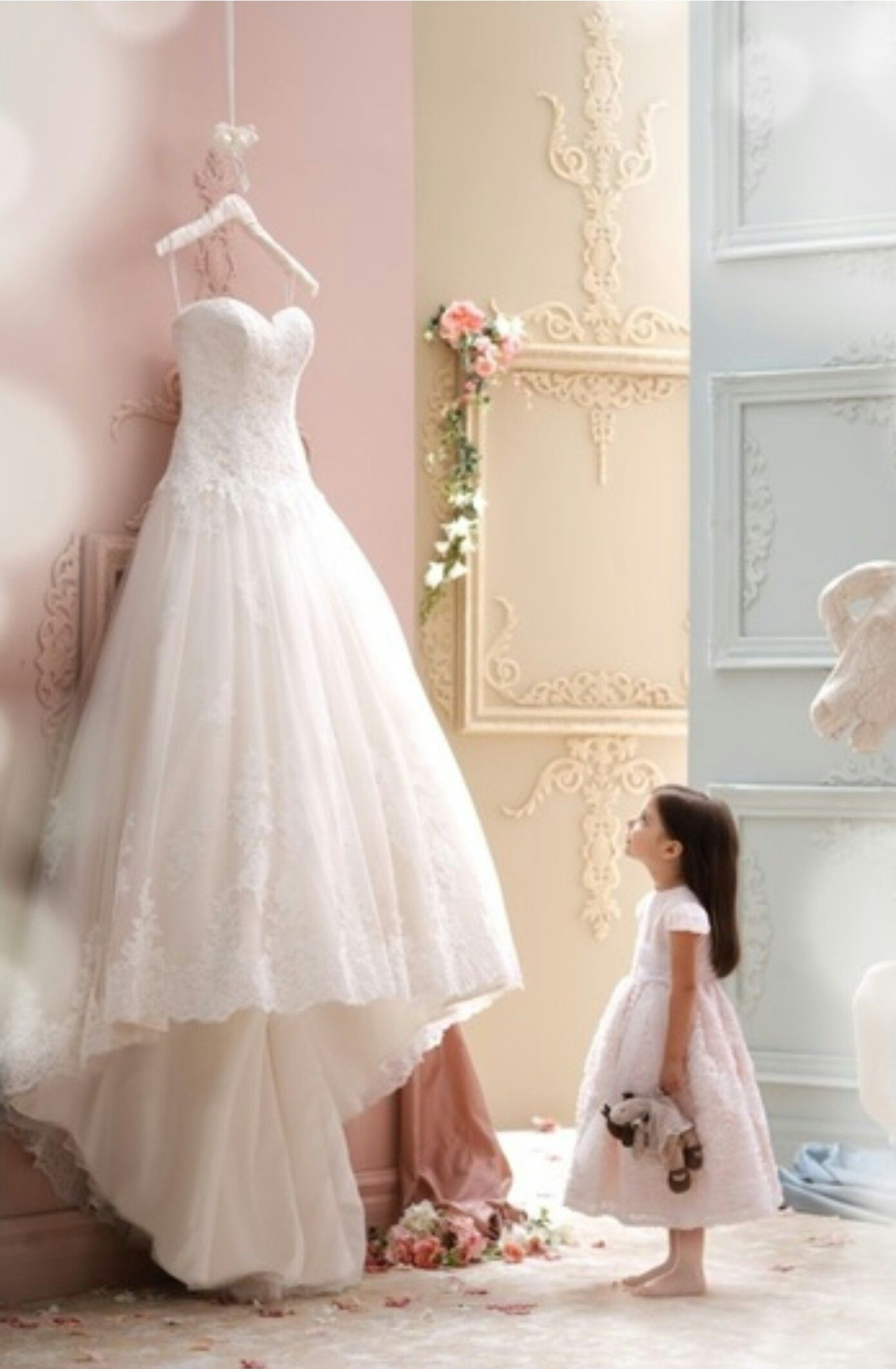 The perfect picture brides dress and the flower girl wedding