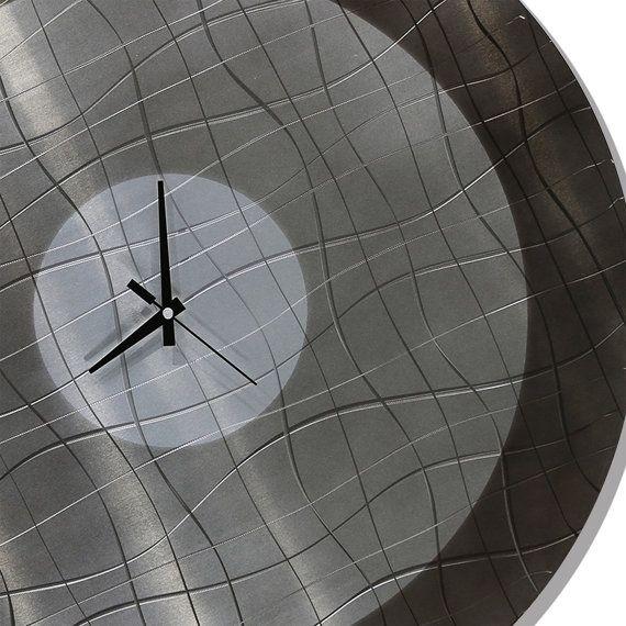 Vibrations in Smoke by Jon Allen https://www.etsy.com/listing/229195976/sale-25-off-modern-wall-clock-metal-wall?ref=shop_home_active_5&utm_content=bufferaf0e8&utm_medium=social&utm_source=pinterest.com&utm_campaign=buffer #timekeeper #grey #metalart #functionalart #modernclock #charcoal #finemetalart #abstractclock #contemporary #clock #jonallen #handmade #hangingwallclock