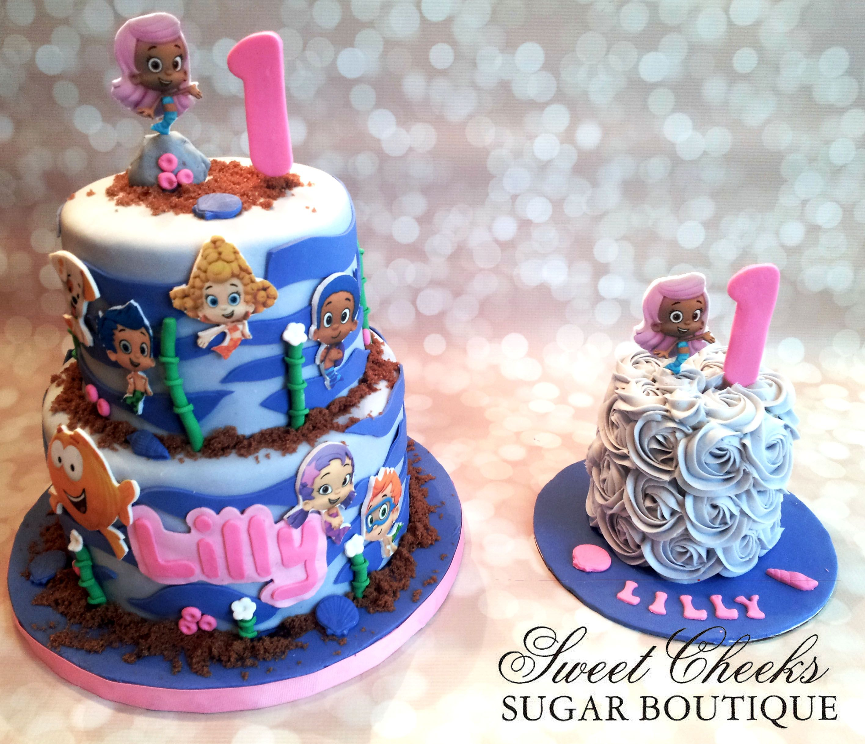 A Bubble Guppies Themed Birthday Cake And Matching Smash Cake