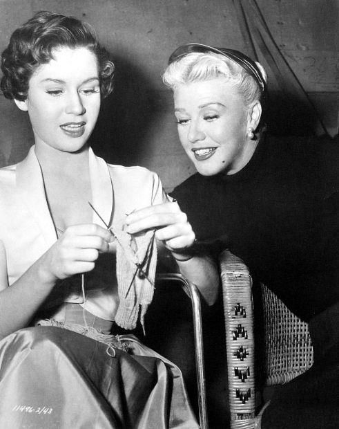 Pat Crowley, receiving some knitting advice from Ginger Rogers.