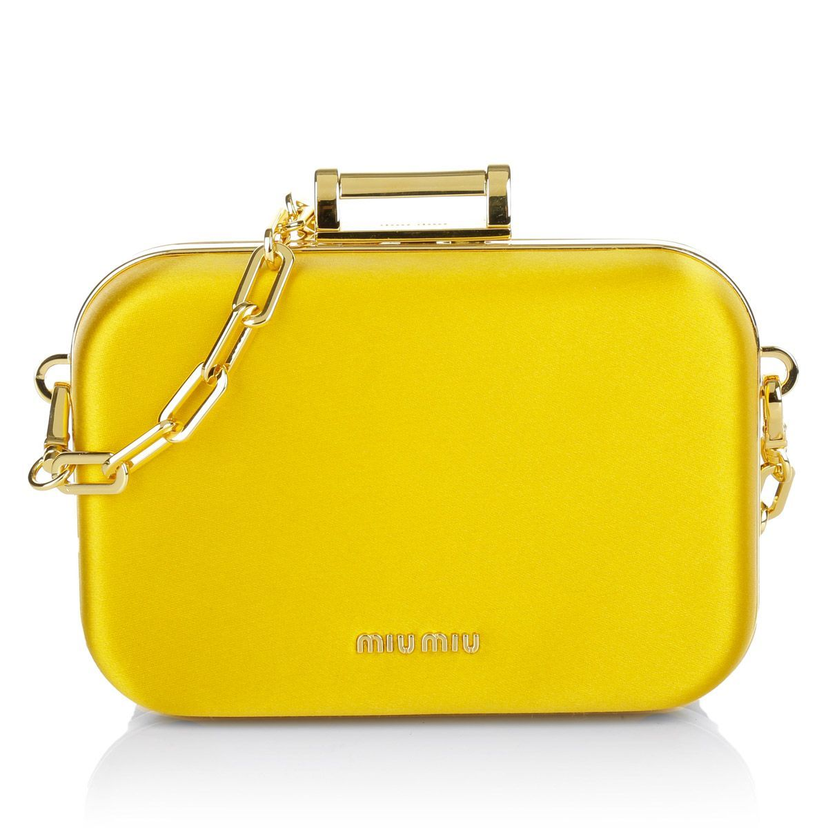 These elegant and unique Miu Miu box bag shines in a very powerful kind of  golden yellow. In fall you add a very glamouros touch to your evening look  and ... f4a851ce12704