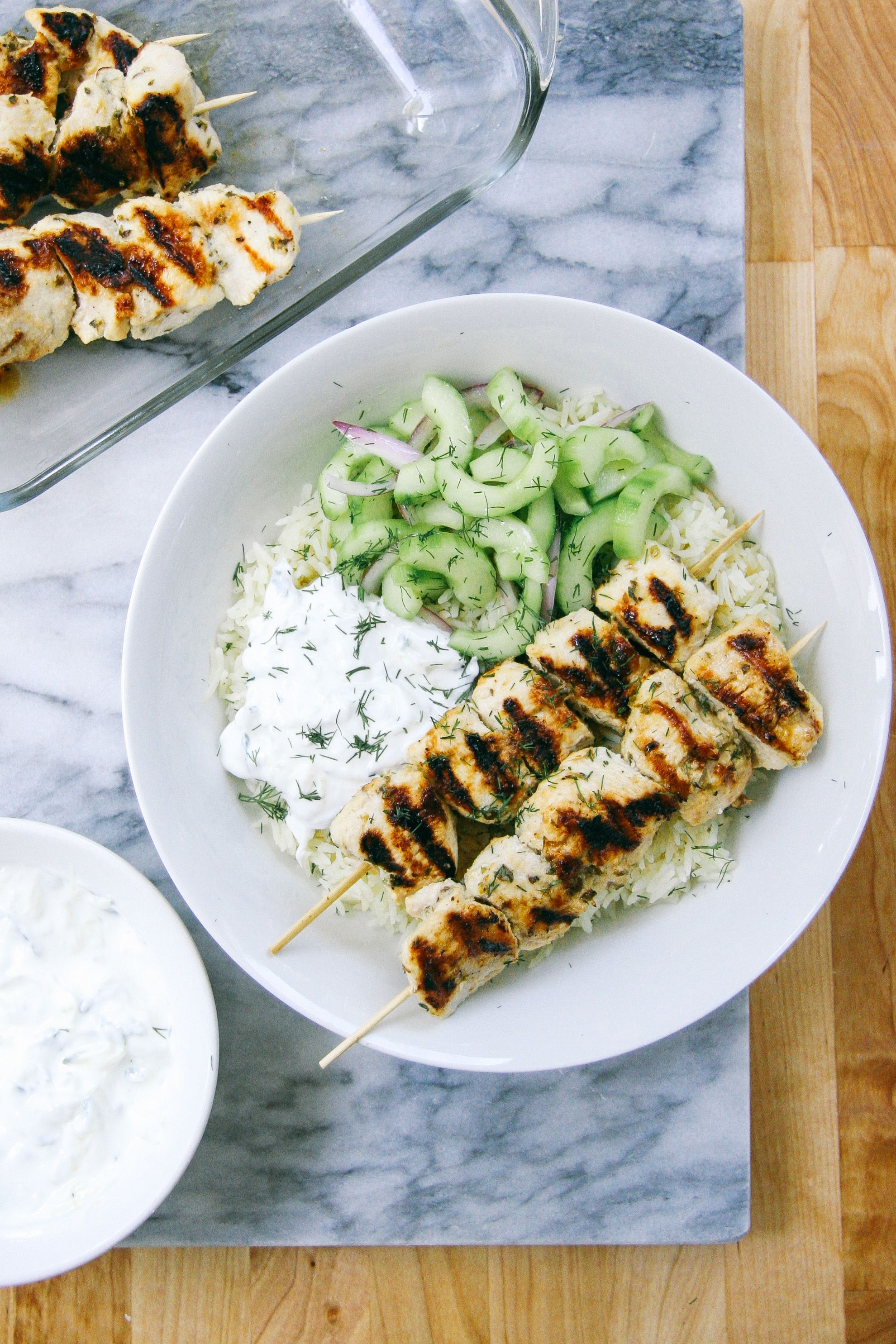 Grilled Chicken Kebab Bowls with Cucumber salad and Tzatziki made with Greek Yogurt.
