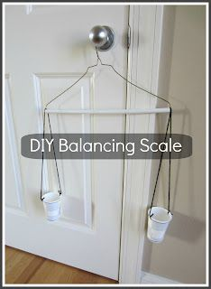 A hanger, yarn, and two disposable cups is all it takes to make a fun balancing scale!