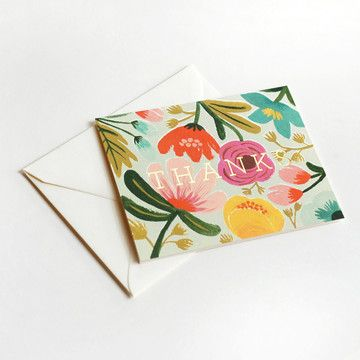 This stately thank you card set features gold metallic text set against a bold, colorful hand-painted background floral arrangement. Available as a boxed set of eight.