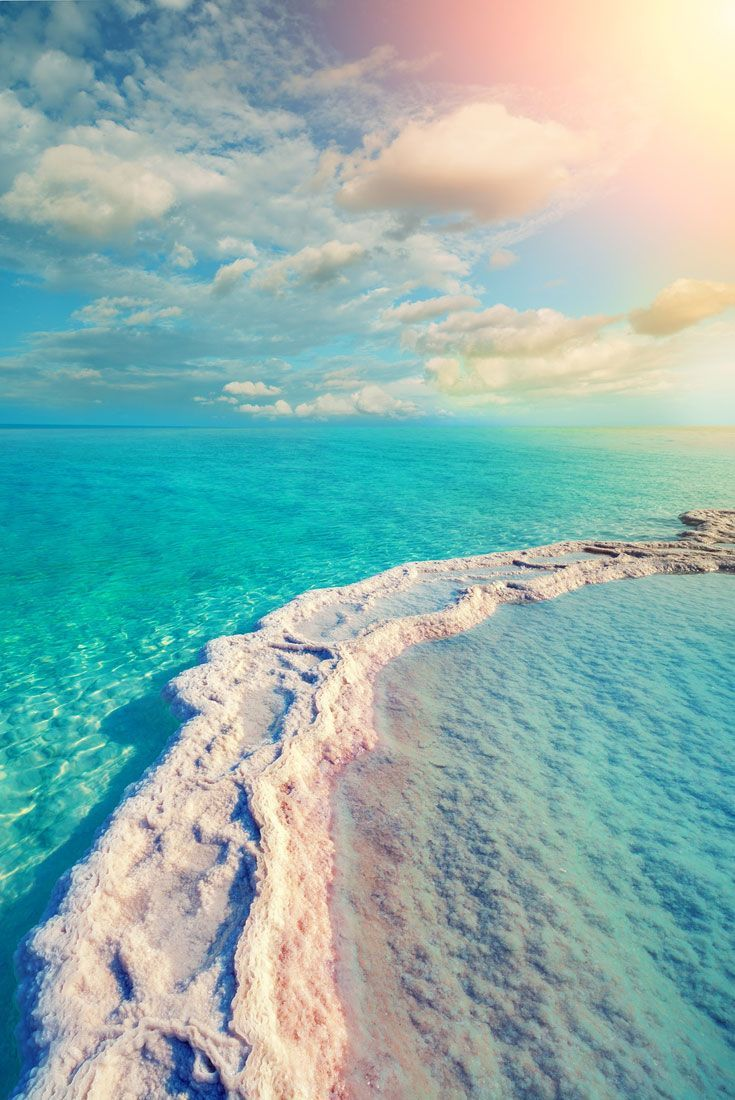 Salt ridges in the shallow water of the Dead Sea, Israel. Visiting the Dead Sea - The Complete guide that will help you make the most of your visit on the Israeli side of the saltiest lake in the lowest place on earth. Including the best free beaches, saf