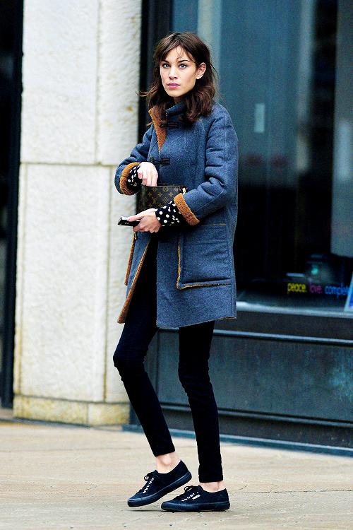 233da26a0196 Alexa Chung in layers; blue and brown winter coat, black leggings, black  lace up shoes, polka dot shirt.