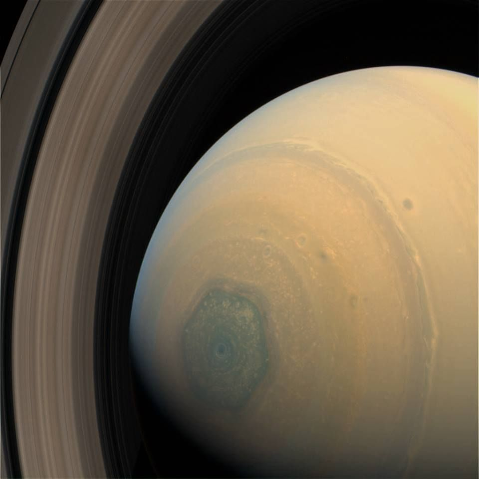 End-on view of Saturn showing the strange hexagonal pattern of clouds near its poles.