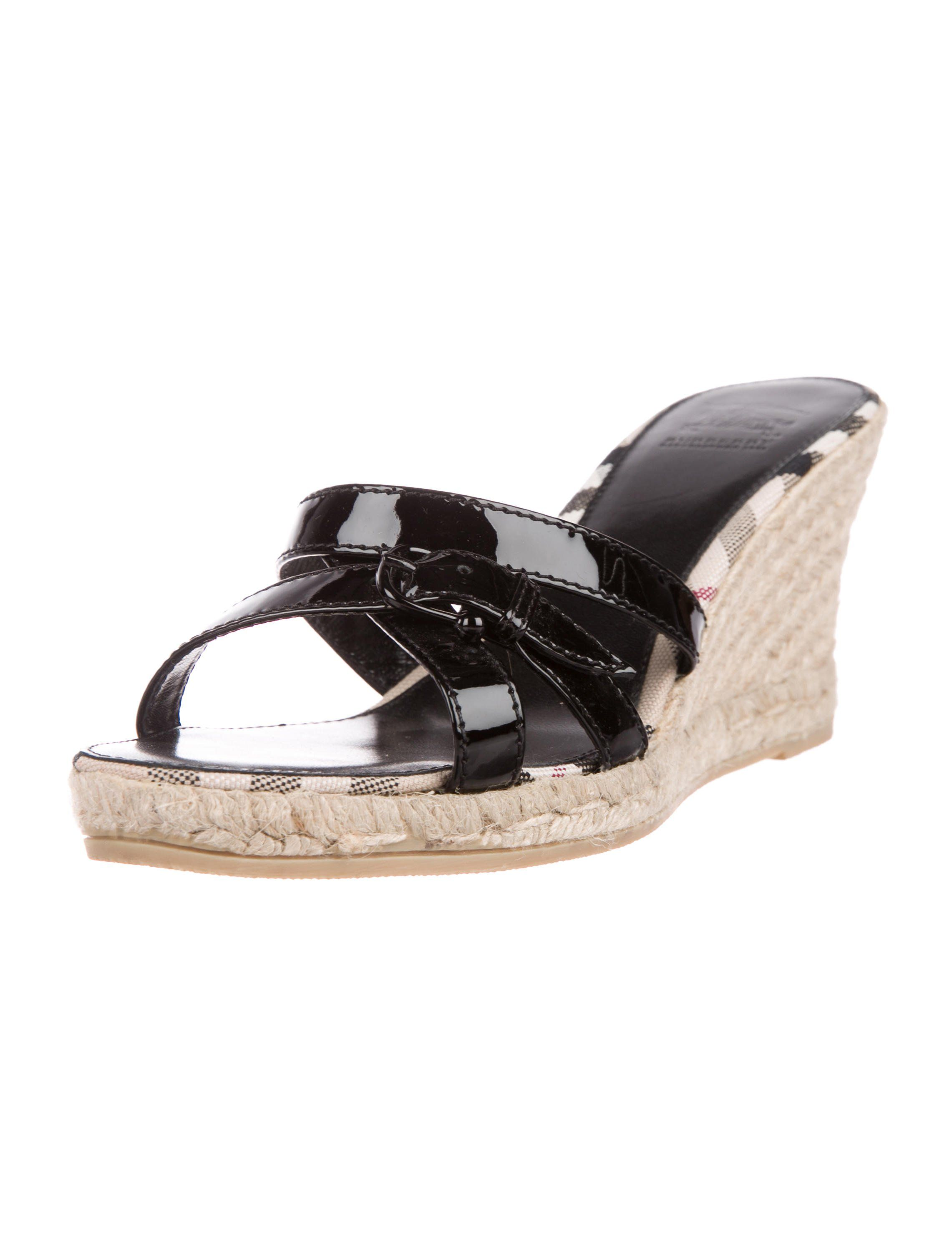 170642cc7 Black patent leather Burberry slide sandals with tan jute-covered wedge  platform soles.