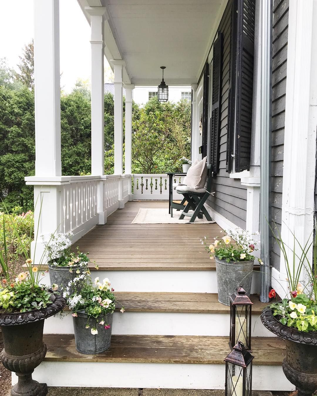 Beautiful Wood Porch With White Railings Gray Siding And Black