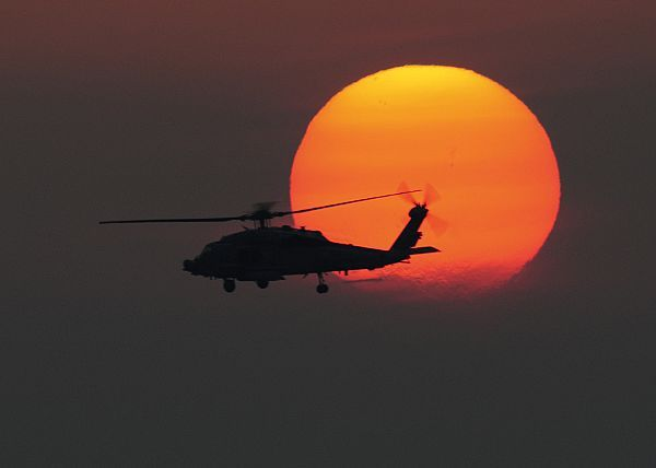 A Usnavy Sea Hawk Assigned To The Nightdippers Helicopter Anti Submarine Squadron Flies Over