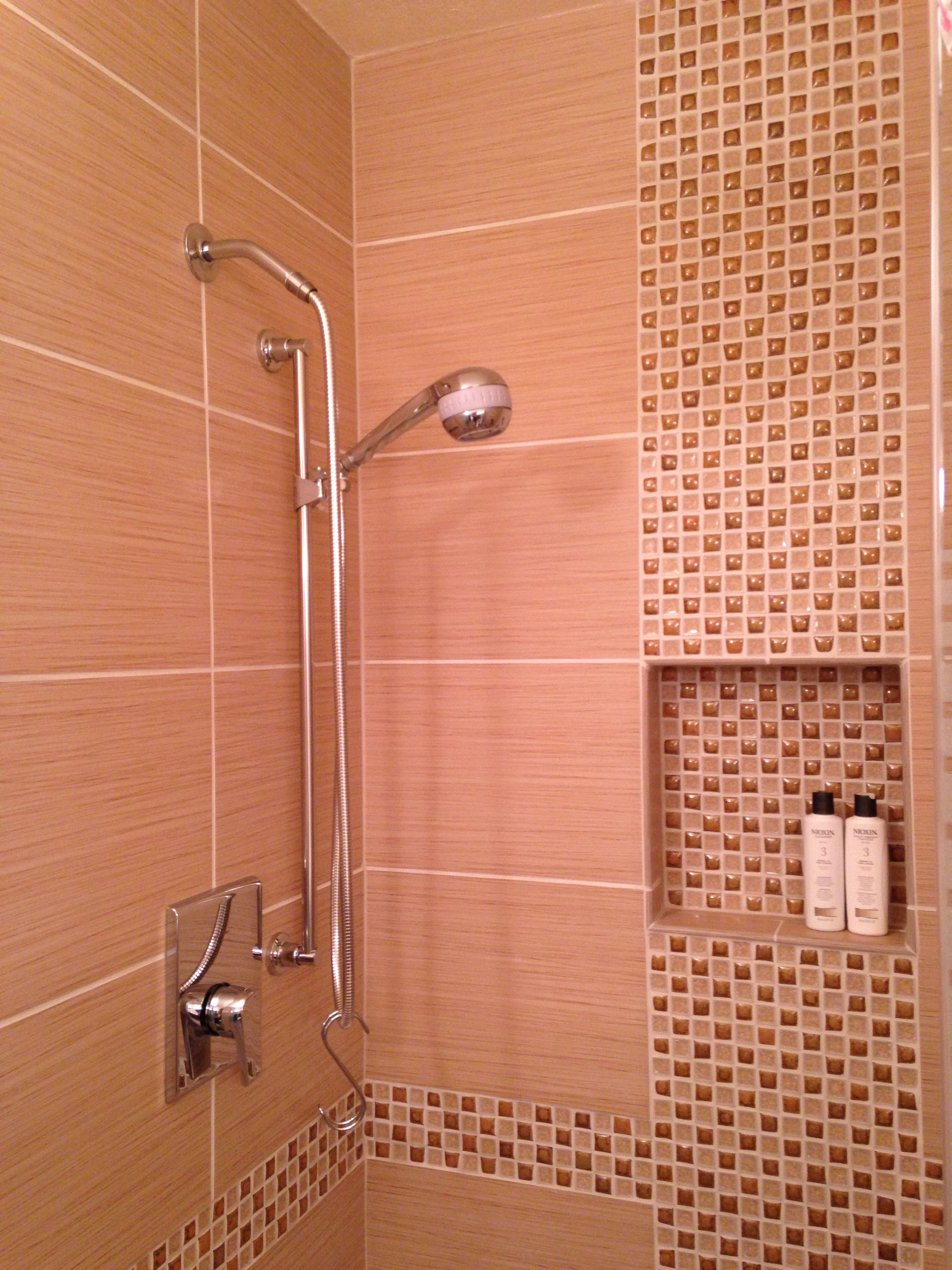 12 X 24 tile with offset vertical mosaic inlay. Shower valve by ...