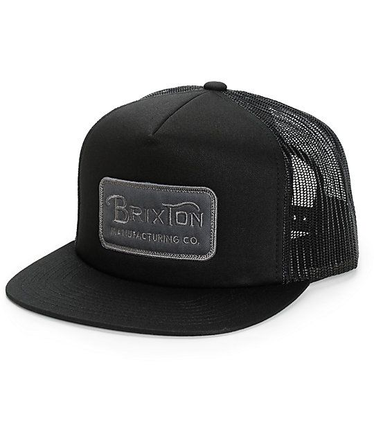 a0763ffb35 Let your dome breath easy with a grey Brixton Manufacturing Co logo patch  on the front of a black crown and black mesh back panels.