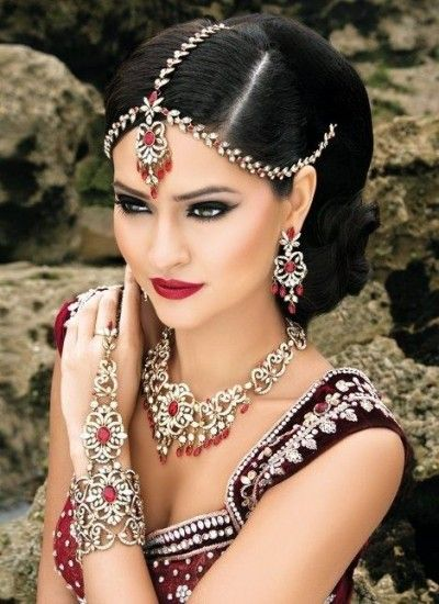 Beautiful Indian wedding updo hairstyle with accessories