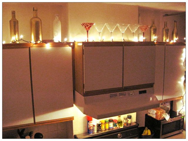 Lighting And Ivy Above Kitchen Cabinets High Shelves Home