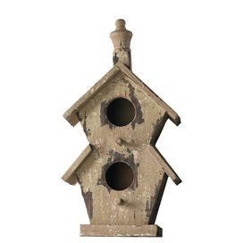 Two-story birdhouse with a weathered finish and turned finial.
