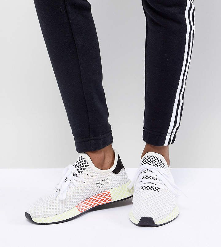 purchase cheap 99c13 8e66d adidas Deerupt Runner Sneakers In White And Yellow