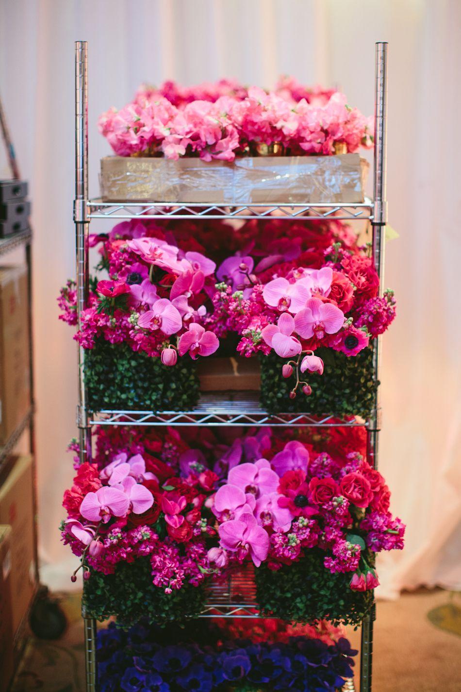 Caravents   www.rjackbalthazar.com unloading bundles of pink floral   ESSENCE BWIH 2014   Photo Credit @paigejonesphoto