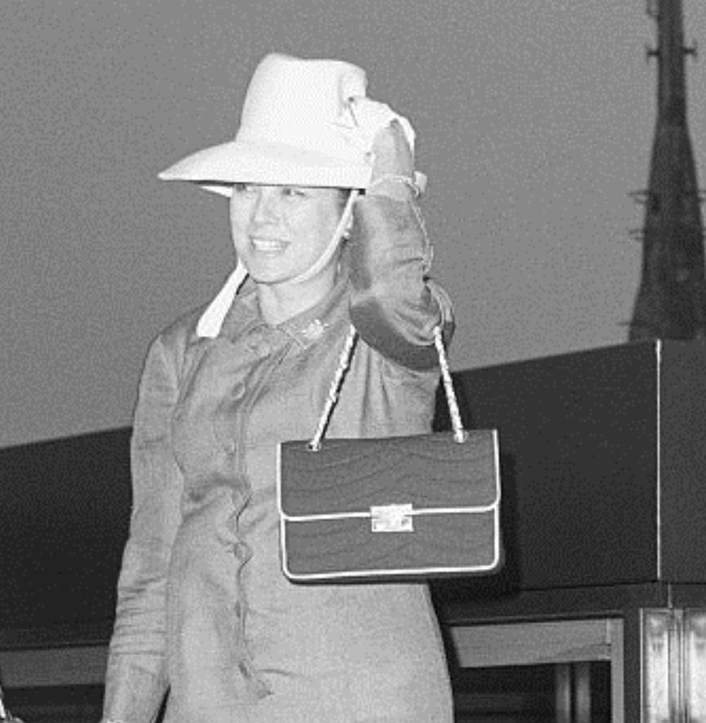 Holding onto her hat as she is caught in the wind created by the helicopter she is about to board, Princess Grace of Monaco is a pretty picture atop the Pan-American building. She helicoptered to Kennedy Airport where she flew to Nice, France after a...