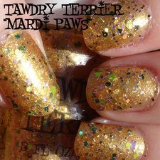 "Tawdry Terrier ""Mardi Paws"" is a shiny warm gold glass fleck polish with a mix of purple, green, and gold glitter. This polish was inspired by Mardi Gras in New Orleans. This is 2 coats in the shade."