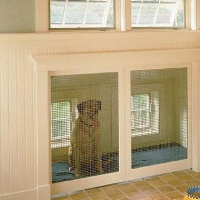 Built In Dog Kennel With A Doggy Door From The Outside As An