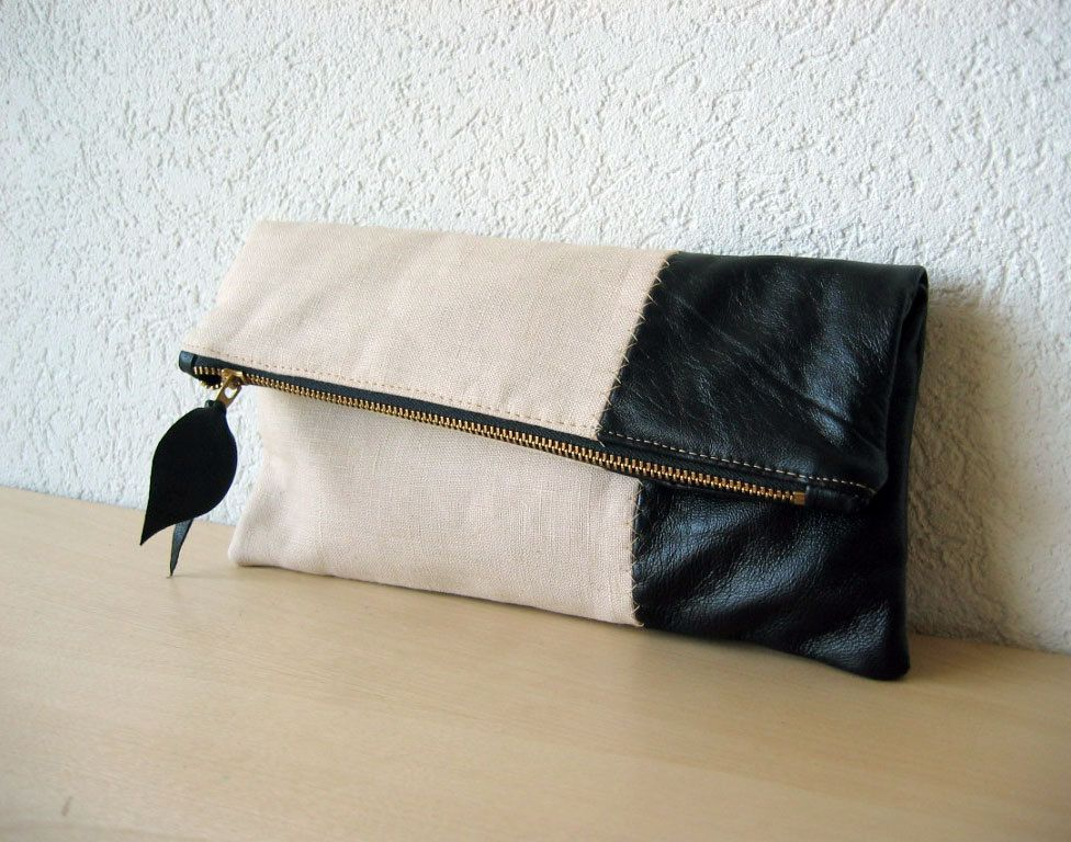leather clutch in black italian leather and beige linen. Black Bedroom Furniture Sets. Home Design Ideas