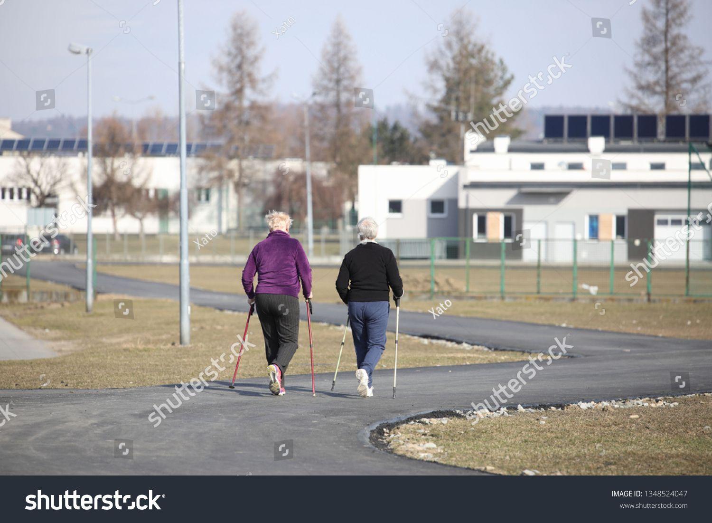 Scandinavian Nordic Walking Two Older Women Are Engaged In Sports