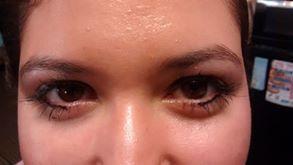 Close up eyeshot. I put a heavy yet thin line of black liquid eyeliner on her. ---->