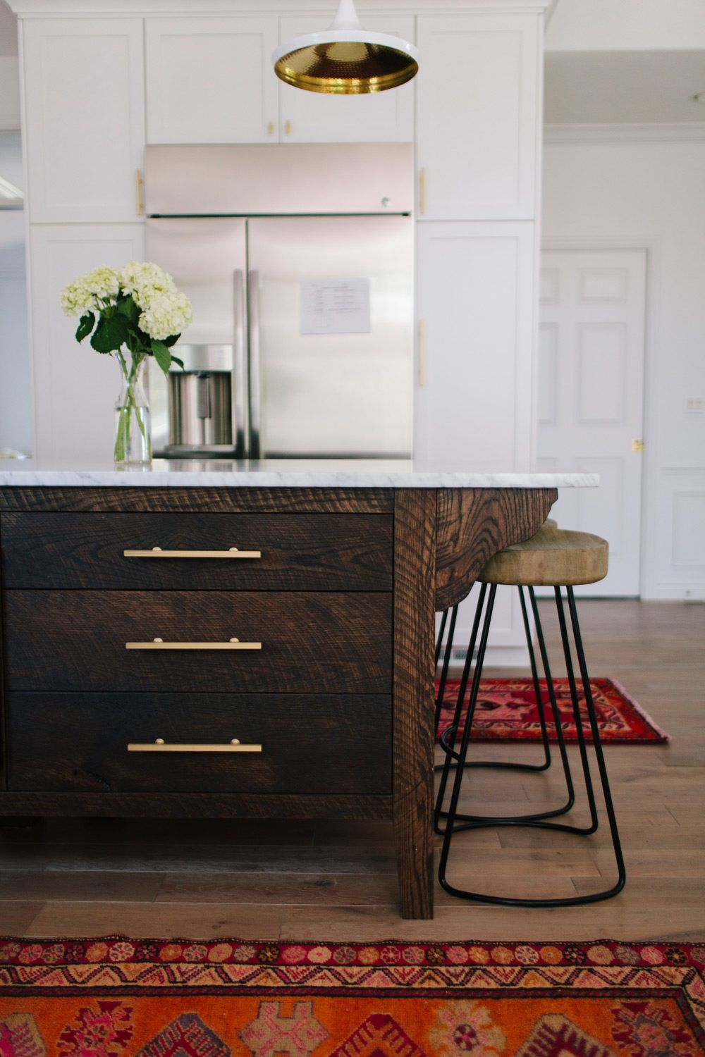 After Falling In Love While Traveling In Europe It S No Surprise That Ali And Jeremy Hynek Dark Wood Kitchen Cabinets Dark Wood Kitchens Wood Kitchen Cabinets
