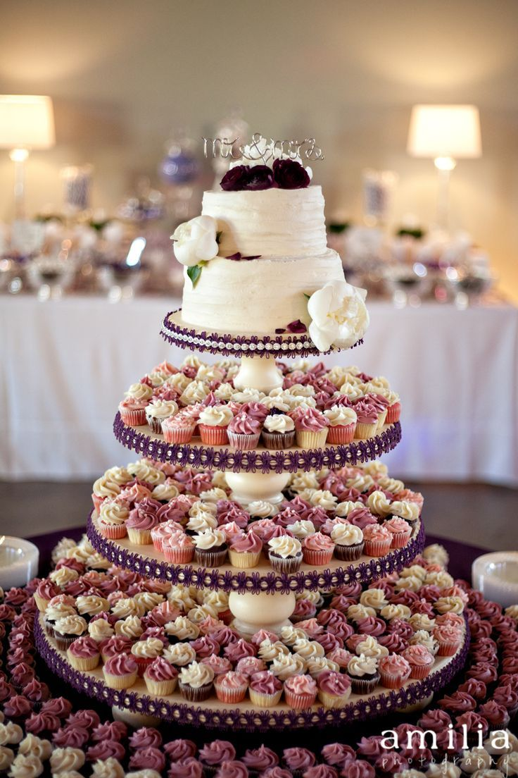 Great idea to have a small cake and then tiers of cupcakes! - -