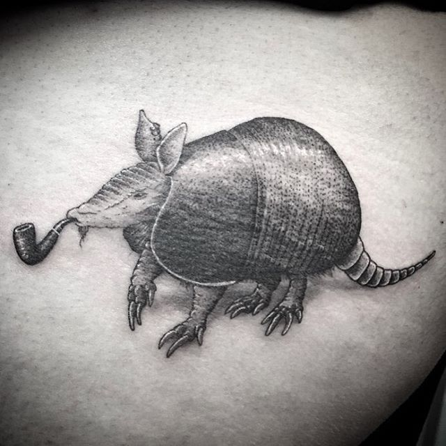 graphic armadilo tattoo