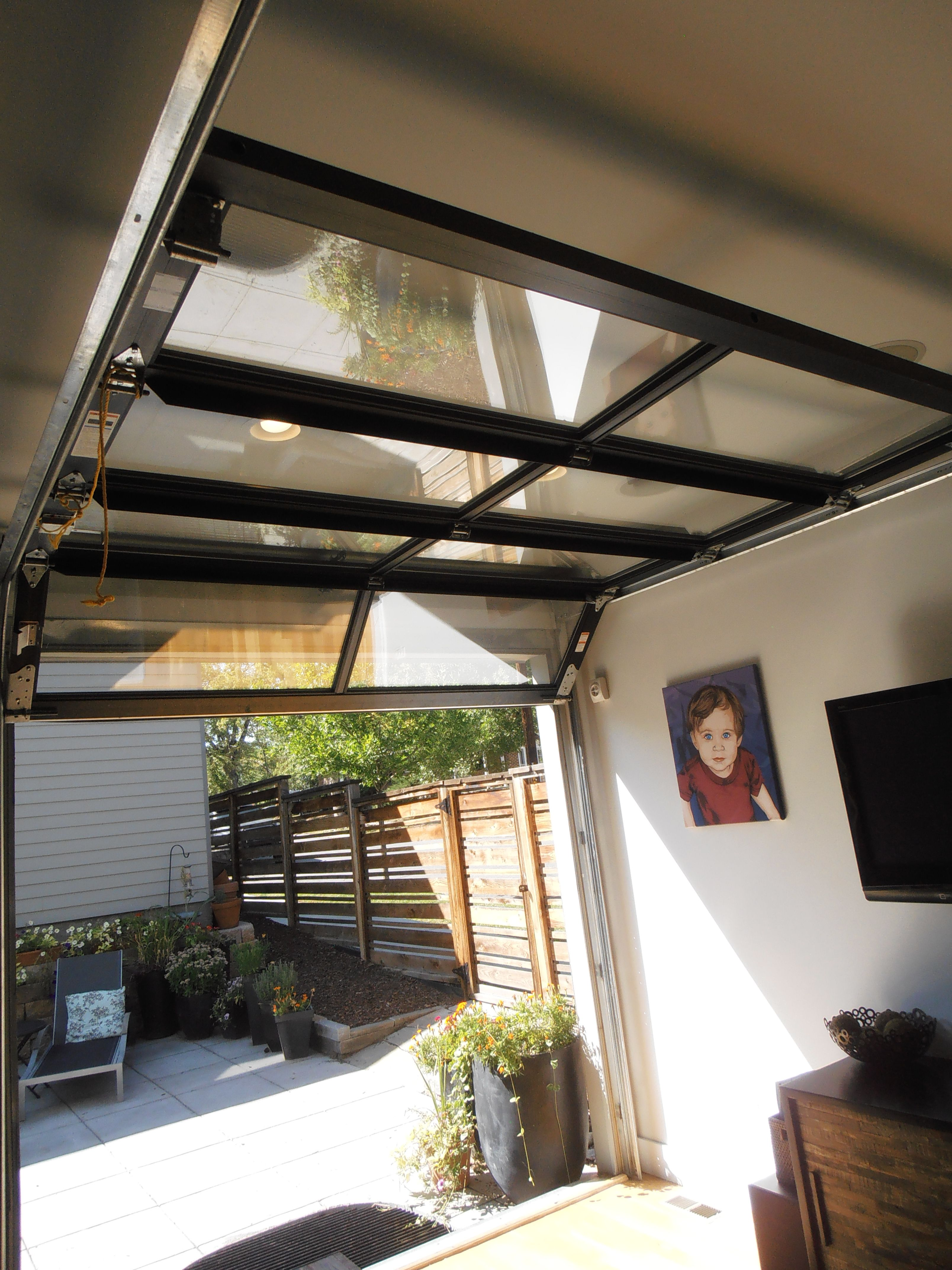 Glass garage door to outdoor patio area opens entire wall to the