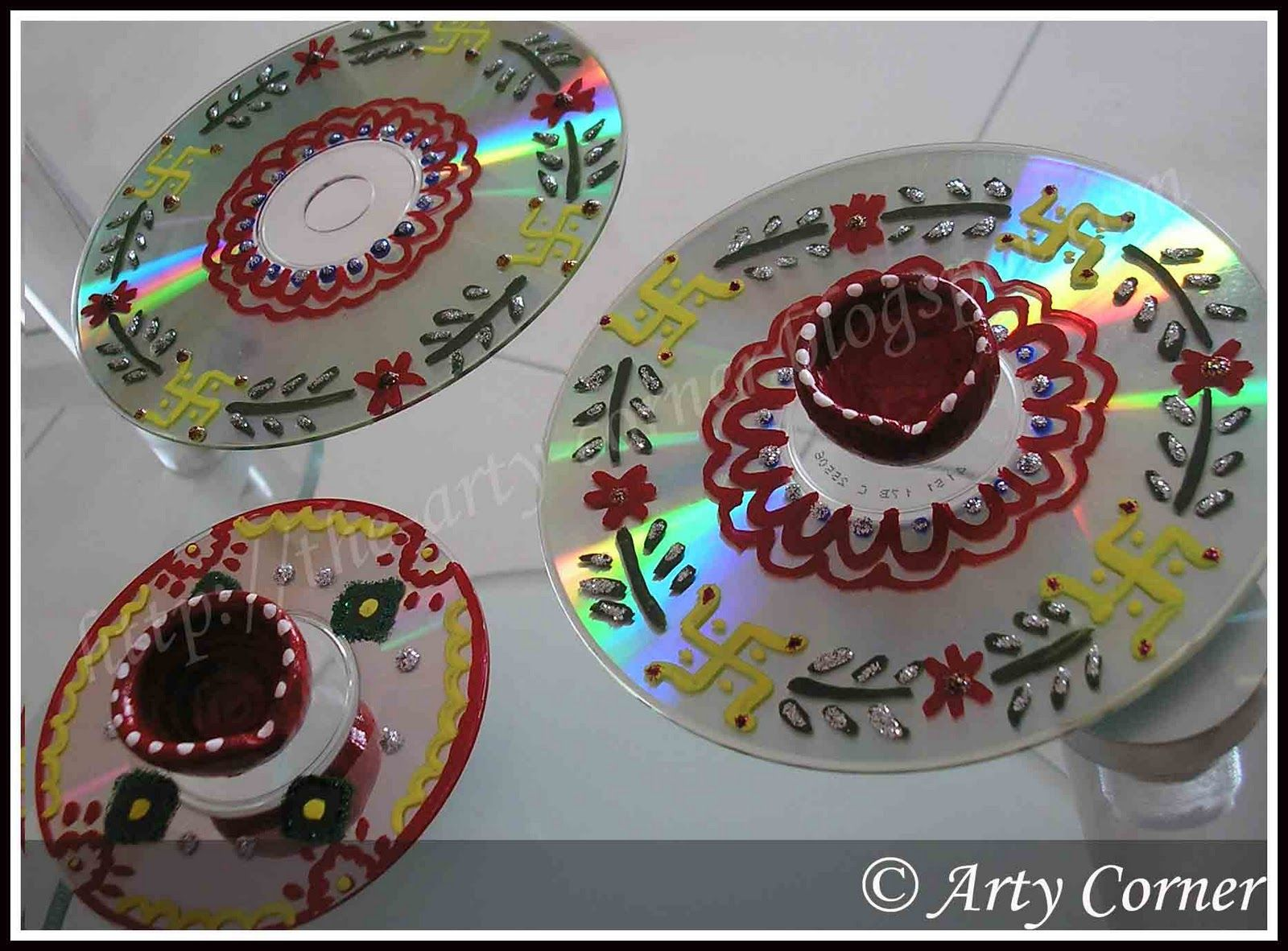 Indian rangoli art diya stand from junk cds craft for Art and craft for diwali decoration