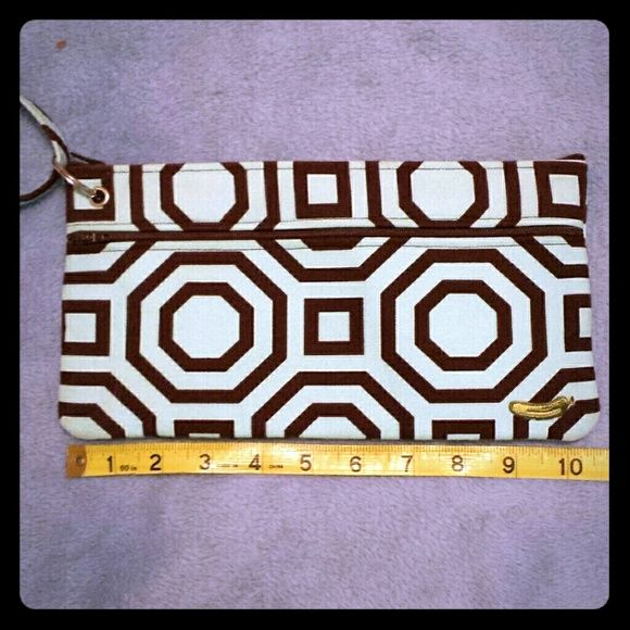 Teal and brown cosmetic bag with strap This geometric patterned cosmetic bag was custom made by Viv Pickle, a Philadelphia handbag boutique.  Has room for lots of goodies and is a great way to keep stuff together. Bags Cosmetic Bags & Cases