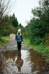 Girl motionless standing at edge of puddle in forest , #Sponsored, #standing, #motionless, #Girl, #forest, #puddle #Ad